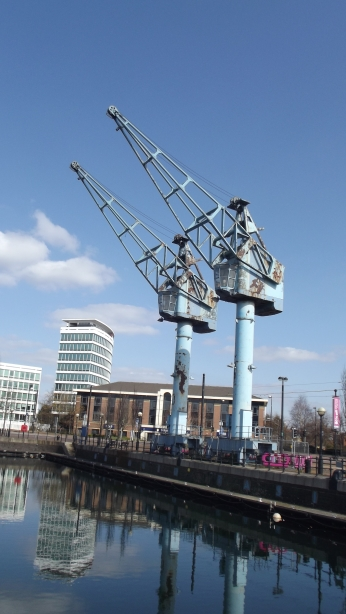 Disused cranes on an empty dock