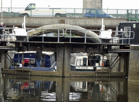 The two wide beams in the lock ready to take off as soon as the gates open