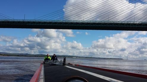 Gordon successfully navigates Ewn Ha Cul through the tide eddies under the old bridge